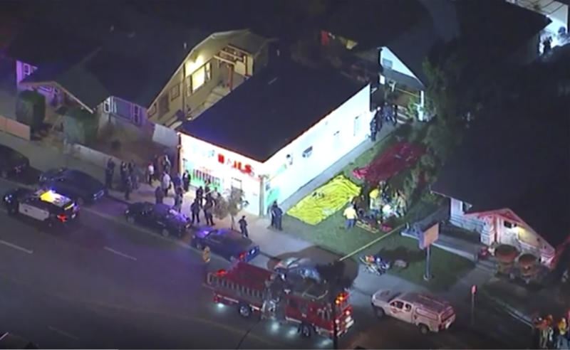 In this aerial image made from video shows the scene where emergency workers have cordoned off an area to deal with victims of a shooting, early Wednesday, Oct. 30, 2019, in Long Beach, Ca. (KABC via AP)