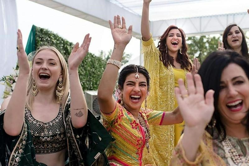 Priyanka Chopra with friends at her wedding (AFP/Getty Images)