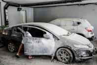 FILE PHOTO: An Israeli man checks his car at the parking area under a residential building in Ashkelon, Israel, which was damaged by a rocket launched overnight from the Gaza Strip