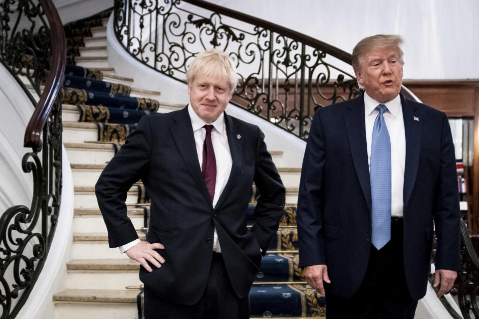 FILE - In this Sunday, Aug. 25, 2019 file photo President Donald Trump and Britain's Prime Minister Boris Johnson, left, speak to the media before a working breakfast meeting at the Hotel du Palais on the sidelines of the G-7 summit in Biarritz, France. British Prime Minister Boris Johnson has said a lot of nice things about Donald Trump over the years, from expressing admiration for the U.S. president to suggesting he might be worthy of the Nobel Peace Prize. But after a mob of Trump supporters invaded the U.S. Capitol on Jan. 6, Johnson has changed his tune.(Erin Schaff, Pool via AP)