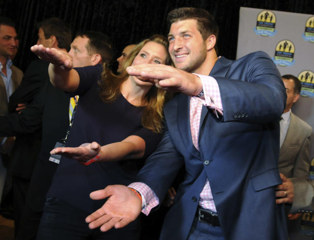 New York Jets quarterback Tim Tebow, right, performs the Gator Chomp after being interviewed by The Weather Channel's Stephanie Abrams on the red carpet for an event before the Tim Tebow Foundation Celebrity Golf Classic, Friday, April 13, 2012, in Ponte Vedra Beach, Fla. (AP Photo/The Florida Times-Union, Bob Mack) TV OUT; MAGS OUT
