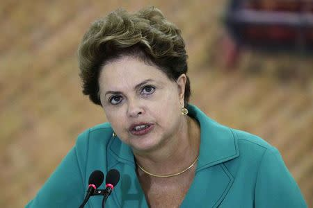 """Brazil's President Rousseff speaks during a ceremony to launch """"Harvest Plan 2014/2015"""" at the Planalto Palace in Brasilia"""