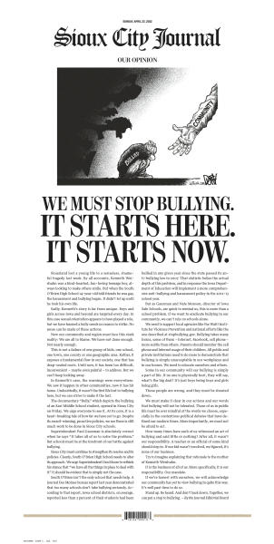 """This image shows the front page of The Sioux City Journal's Sunday, April 22, 2012, edition, featuring a full-page piece to an anti-bullying editorial after a gay teen committed suicide. The Sioux City Journal's front-page opinion piece calls on the community to be pro-active in stopping bullying and urges members to learn more about the problem by seeing the acclaimed new film, """"Bully,"""" which documents the harassment of Sioux City middle school student. Relatives have said 14-year-old Kenneth Weishuhn Jr. suffered intense harassment, including threatening cellphone calls and nasty comments posted online, after coming out to family and friends about a month ago. He died April 15 from what the local sheriff's office described only as a """"self-inflicted injury."""" (AP Photo/The Sioux City Journal)"""