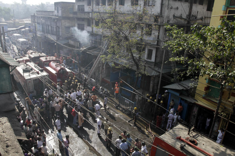 Firefighters douse a fire after a fire broke out early morning at an illegal six-story plastics market in Kolkata, India, Wednesday, Feb.27, 2013. More than a dozen people were killed and others were hospitalized in critical condition. (AP Photo/Bikas Das)