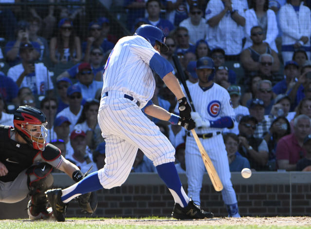 Chicago Cubs' Ben Zobrist (18) hits a two-RBI double against the Cincinnati Reds during the eighth inning of a baseball game Saturday, July 7, 2018, in Chicago. (AP Photo/David Banks)