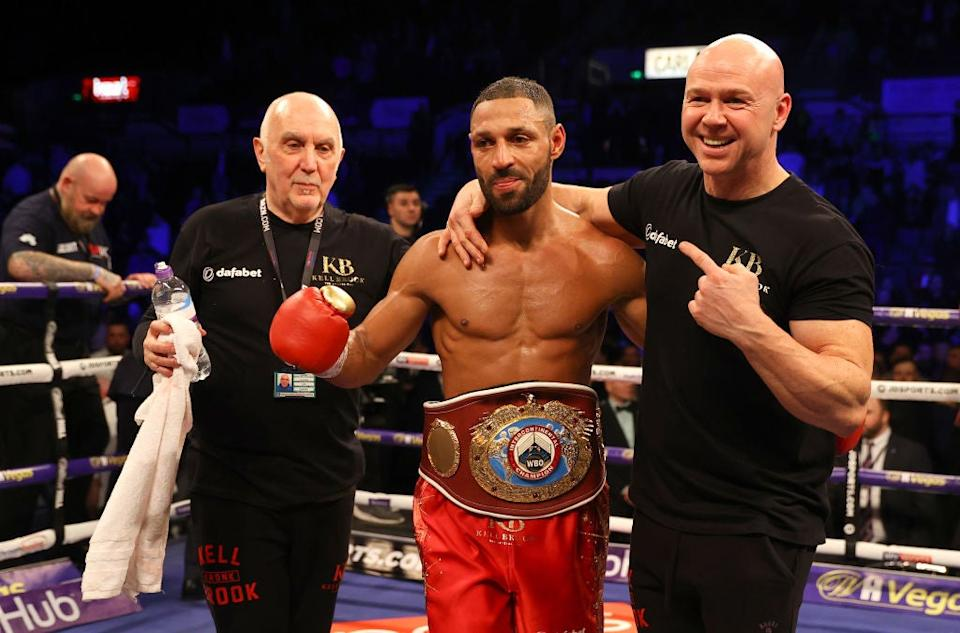 Kell Brook celebrates victory with Dom Ingle in February over Mark DeLucaGetty