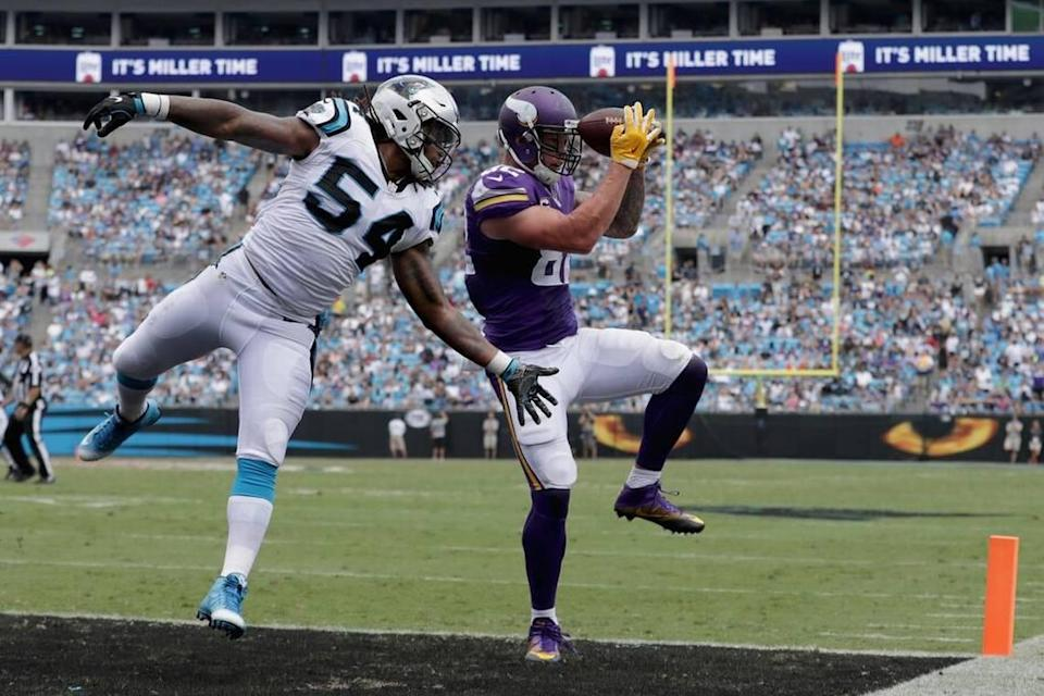 Kyle Rudolph #82 of the Minnesota Vikings catches a touchdown pass against Shaq Green-Thompson #54 of the Carolina Panthers in the 3rd quarter during their game at Bank of America Stadium on September 25, 2016 in Charlotte, North Carolina. (Photo by Streeter Lecka/Getty Images)