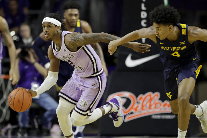Kansas State's Cartier Diarra (2) drives past West Virginia's Miles McBride (4) during the second half of an NCAA college basketball game Saturday, Jan. 18, 2020 in Lawrence, Kan. Kansas State won 84-68. (AP Photo/Charlie Riedel)