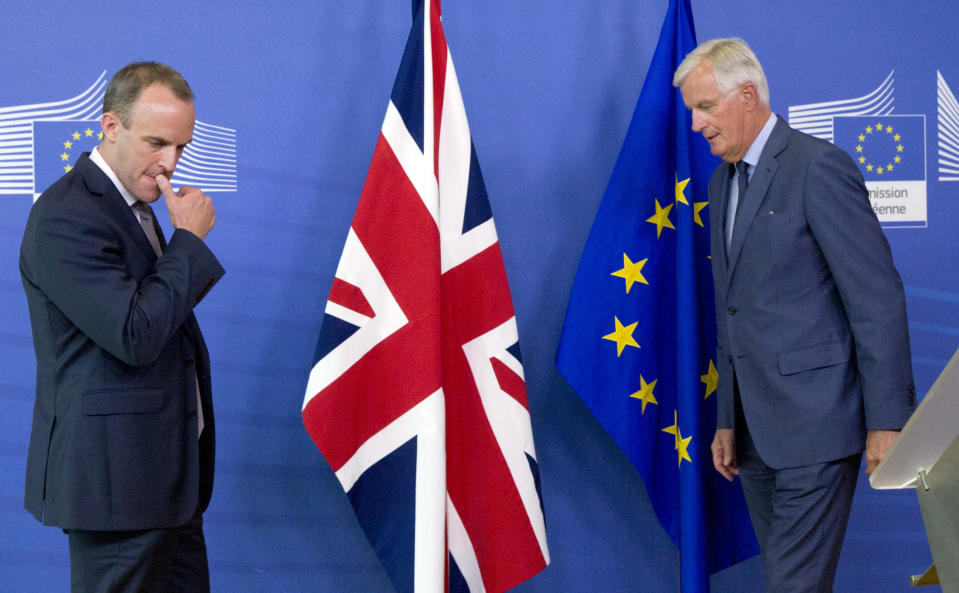 FILE - In this Friday, Aug. 31, 2018 file photo, Britain's Secretary of State for Exiting the European Union Dominic Raab, left, and EU chief Brexit negotiator Michel Barnier prepare to shake hands after a media conference at EU headquarters in Brussels. Britain and the European Union have struck a provisional free-trade agreement that should avert New Year's chaos for cross-border commerce and bring a measure of certainty to businesses after years of Brexit turmoil. The breakthrough on Thursday, Dec. 24, 2020 came after months of tense and often testy negotiations that whittled differences down to three key issues: fair-competition rules, mechanisms for resolving future disputes and fishing rights. (AP Photo/Virginia Mayo, File)