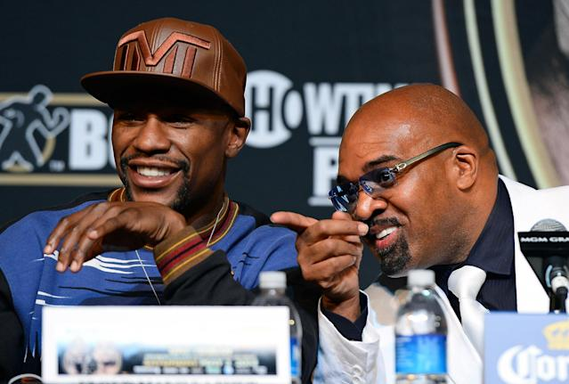 LAS VEGAS, NV - APRIL 30: WBC welterweight champion Floyd Mayweather Jr. (L) and CEO of Mayweather Promotions Leonard Ellerbe attend a news conference at the MGM Grand Hotel/Casino on April 30, 2014 in Las Vegas, Nevada. Mayweather will fight WBA champion Marcos Maidana in a WBC/WBA unification fight in Las Vegas on May 3. (Photo by Ethan Miller/Getty Images)