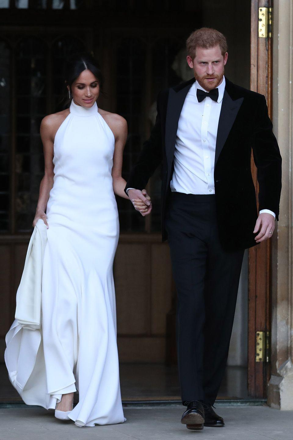 """<p>Again, when you're royalty, you get two wedding dresses. Meghan changed into a sexy halter-neck Stella McCartney white dress for her wedding reception at Frogmore House.</p><p><strong>RELATED</strong>: <a href=""""https://www.goodhousekeeping.com/life/a34407473/the-queen-shut-down-prince-harry-meghan-markle-wedding-day-tiara/"""" rel=""""nofollow noopener"""" target=""""_blank"""" data-ylk=""""slk:The Queen Reportedly Shut Down Prince Harry's Demand That Meghan Markle Get Her Way on Her Wedding Day"""" class=""""link rapid-noclick-resp"""">The Queen Reportedly Shut Down Prince Harry's Demand That Meghan Markle Get Her Way on Her Wedding Day</a></p>"""