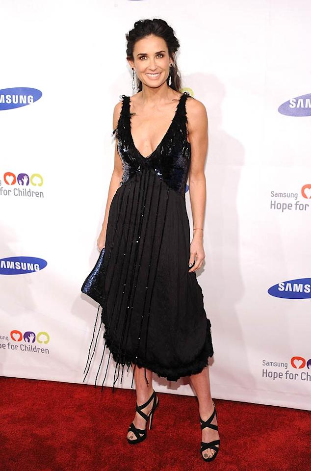"""48-year-old Demi Moore put women half her age to shame at the star-studded Hope for Children soiree in a black Louis Vuitton Pre-Fall 2011 V-neck dress and matching Jimmy Choo """"Vamp"""" sandals. Dimitrios Kambouris/<a href=""""http://www.wireimage.com"""" target=""""new"""">WireImage.com</a> - June 7, 2011"""
