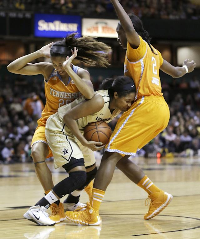 Vanderbilt guard Morgan Batey, center, is trapped by Tennessee defenders Isabelle Harrison, left, and Jasmine Jones (2) in the first half of an NCAA college basketball game, Sunday, Jan. 12, 2014, in Nashville, Tenn. (AP Photo/Mark Humphrey)