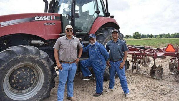 PHOTO: Eddie Lewis III poses with his brother and grandfather at Lewis Farms. (Eddie Lewis III )
