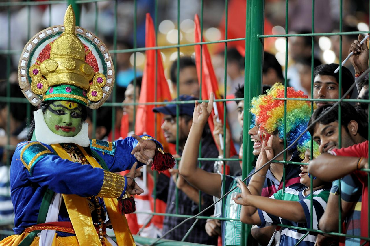 Dancers from Kerala at the stadium during RCB vs MI match in Bangalore on April 4, 2013. (Photo: IANS)
