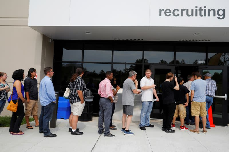 """FILE PHOTO: Job seekers line up to apply during """"Amazon Jobs Day"""" at the Amazon.com Fulfillment Center in Fall River"""
