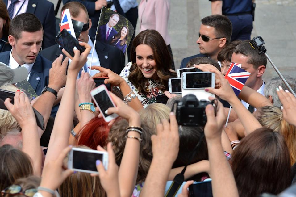 <p><b><b><b>The Duchess of Cambridge was greeted like a celebrity, phone cameras en mass, during a visit to the Dlugi Targ market in Gdansk on the second day of the tour. <em>[Photo: PA]</em> </b></b></b></p>