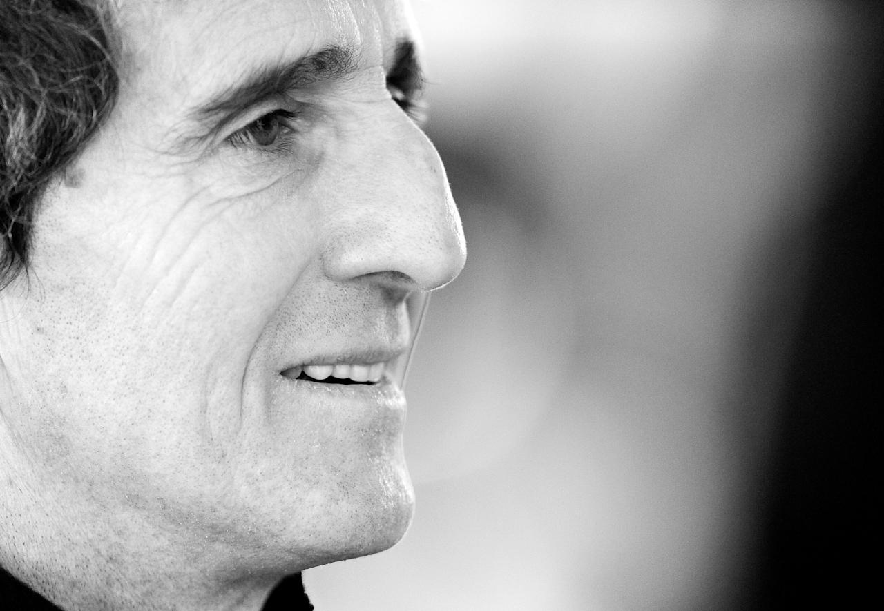 DUESSELDORF, GERMANY - NOVEMBER 28:  (EDITORS NOTE: This Image Has Been Converted To Black & White). Alain Prost of France ponders during the second day of the race of champions event at the Esprit Arena on November 28, 2010 in Duesseldorf, Germany.  (Photo by Stuart Franklin/Bongarts/Getty Images)