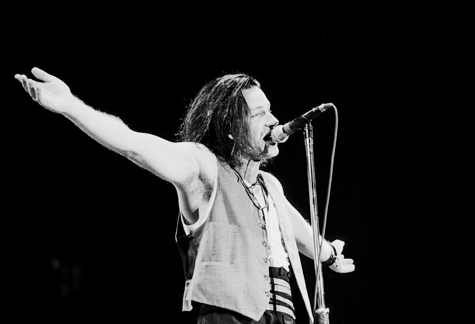Irish Rock musician Bono (born Paul Hewson), of the group U2, performs onstage at Giants Stadium durign the band's 'Joshua Tree' tour, East Rutherford, New Jersey, September 14, 1987. (Photo by Gary Gershoff/Getty Images)