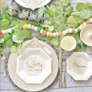 """<p>Eid decor isn't complete without traditional gold accents, but this colorful pompom garland keeps things playful without clashing against the warm tones. Whether you're a DIY lover or a store-bought queen, layering it atop a foliage garland turns the kids' craft into a sophisticated staple like in this table setting by <a href=""""https://www.instagram.com/p/CORVeorD-vs/"""" rel=""""nofollow noopener"""" target=""""_blank"""" data-ylk=""""slk:The Suri Corner"""" class=""""link rapid-noclick-resp"""">The Suri Corner</a>.</p>"""
