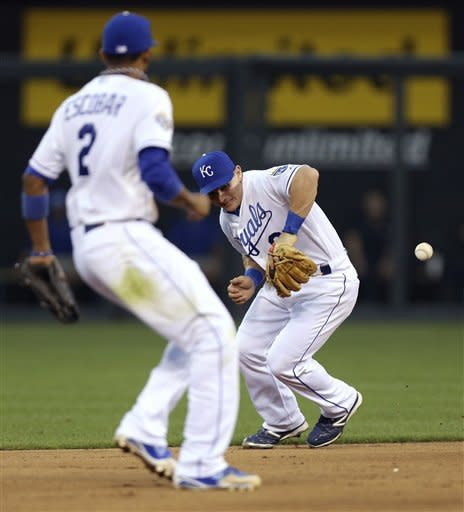 A ball hit by Los Angeles Angels' Alberto Callaspo bounces off the glove of Kansas City Royals second baseman Johnny Giavotella in the fifth inning during a baseball game Saturday, Sept. 15, 2012, in Kansas City, Mo. Callaspo reached first on Giavotella's fielding error. (AP Photo/Ed Zurga)