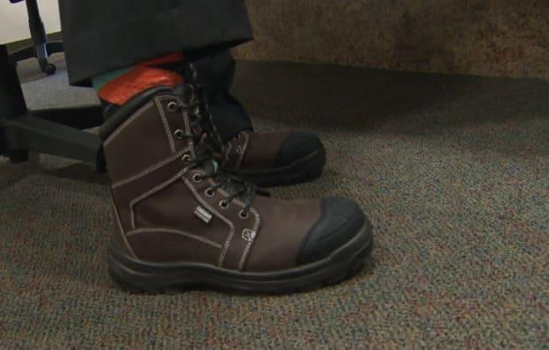 Hickes wore the same pair of work boots he sported for budget day last year, saying he hasn't had time to take them off.