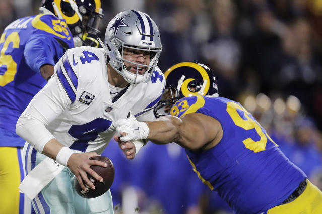 Dallas Cowboys quarterback Dak Prescott was pressured often by the Rams on Saturday night. (AP)