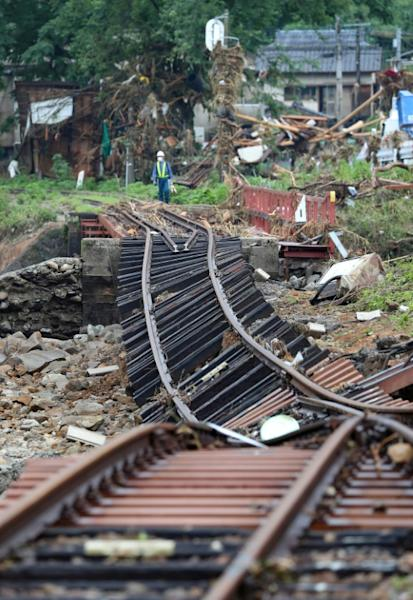 A railway track was severly damaged by the flooding in Kumamura