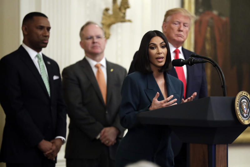 President Donald Trump listens to Kim Kardashian West, who is among the celebrities who have advocated for criminal justice reform, speak during an event on second chance hiring in the East Room of the White House, Thursday, June 13, 2019, in Washington.