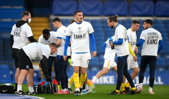 Brighton and Hove Albion players wearing shirts opposing the proposed European Super League, before during the Premier League match at Stamford Bridge