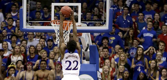 Kansas' Andrew Wiggins dunks the ball during the second half of an NCAA college basketball game against the Louisiana Monroe on Friday, Nov. 8, 2013, in Lawrence, Kan. (AP Photo/Charlie Riedel)