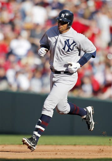 New York Yankees' Alex Rodriguez rounds the bases on a solo home run in the fifth inning of a baseball game against the Boston Red Sox in Boston, Friday, April 20, 2012. (AP Photo/Michael Dwyer)