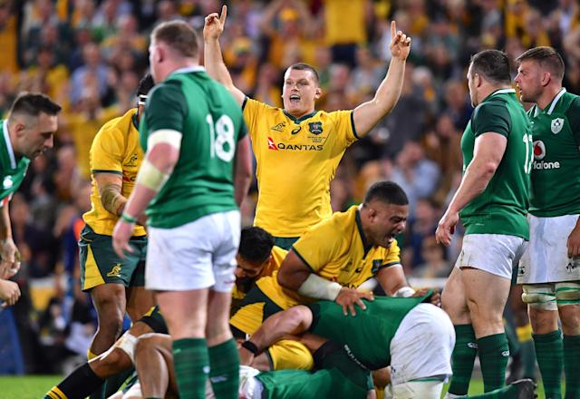 Rugby Union - June Internationals - Australia vs Ireland - Lang Park, Brisbane, Australia - June 9, 2018 - Tom Robertson of Australia celebrates after team mate David Pocock scored a try. AAP/Darren England/via REUTERS ATTENTION EDITORS - THIS IMAGE WAS PROVIDED BY A THIRD PARTY. NO RESALES. NO ARCHIVE. AUSTRALIA OUT. NEW ZEALAND OUT.