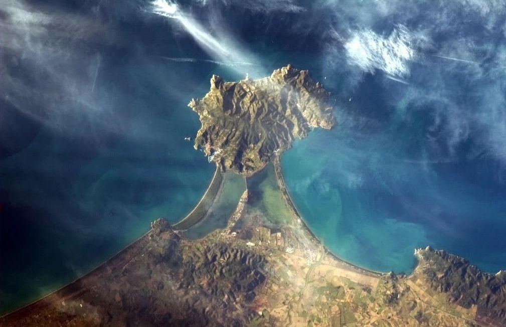 Hadfield captured a view of the Italian coast using one of the International Space Station's Nikon cameras. ' like a diamond set in a ring,' he Tweeted.