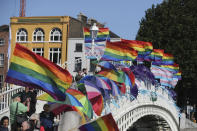 Rainbow flags and blue ribbons are tied to Ha'Penny Bridge, Dublin to remember the victims of Catholic Church clerical sex abuse, ahead of the arrival of Pope Francis, in Dublin, Ireland, Saturday, Aug. 25, 2018. The pontiff is traveling to Ireland for a two-day visit on the occasion of the 2018 World Meeting of Families. (Niall Carson/PA via AP)