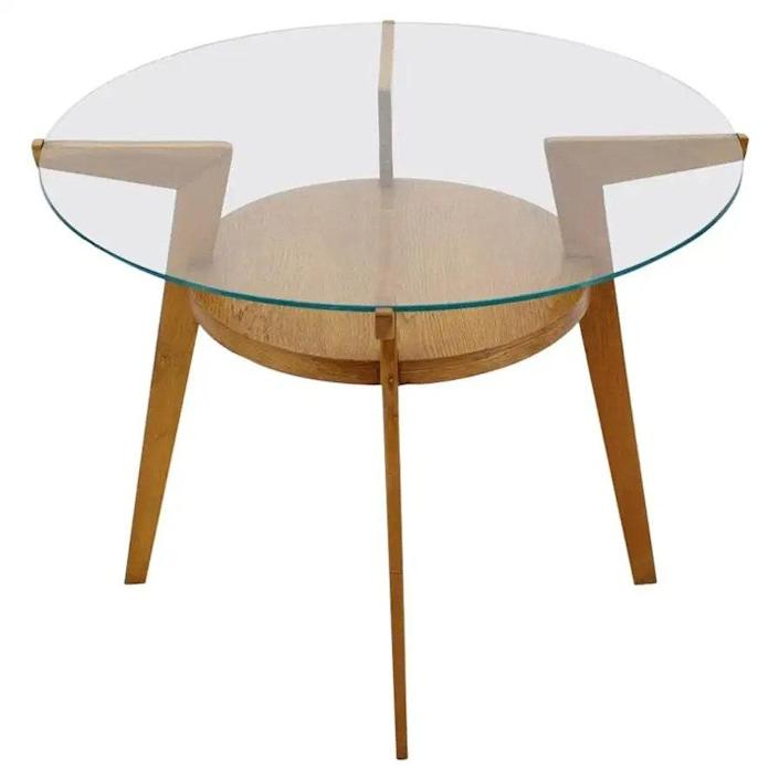 """$458, 1st Dibs. <a href=""""https://www.1stdibs.com/furniture/tables/coffee-tables-cocktail-tables/1960s-oak-glass-coffee-table-czechoslovakia/id-f_18850122/"""" rel=""""nofollow noopener"""" target=""""_blank"""" data-ylk=""""slk:Get it now!"""" class=""""link rapid-noclick-resp"""">Get it now!</a>"""