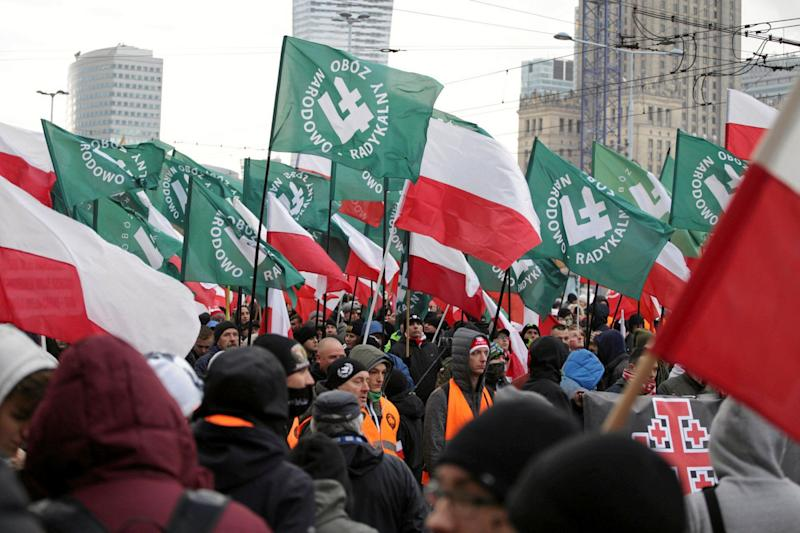 Protesters carry Polish flags and National Radical Camp flags during a rally organized by far-right, nationalist groups to mark the 99th anniversary of Polish independence in Warsaw, Poland, on Nov. 11, 2017.