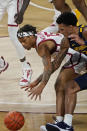 Oklahoma guard Alondes Williams (15) and West Virginia forward Jalen Bridges, right, reach for the ball in the first half of an NCAA college basketball game Saturday, Jan. 2, 2021, in Norman, Okla. (AP Photo/Sue Ogrocki)