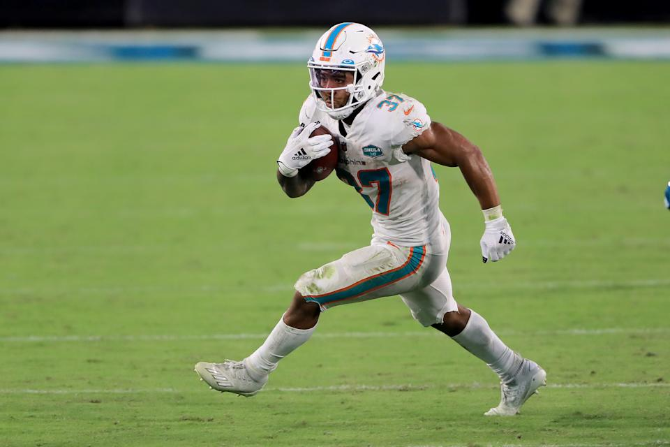 JACKSONVILLE, FLORIDA - SEPTEMBER 24: Myles Gaskin #37 of the Miami Dolphins runs for yardage during the game against the Jacksonville Jaguars at TIAA Bank Field on September 24, 2020 in Jacksonville, Florida. (Photo by Sam Greenwood/Getty Images)