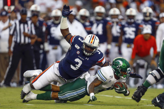 FILE - In this Sept. 7, 2019, file photo, Tulane running back Amare Jones is tackled for a loss by Auburn defensive end Marlon Davidson (3) during the first quarter of an NCAA college football game in Auburn, Ala. Davidson was selected by the Atlanta Falcons in the second round of the NFL football draft Friday, April 24, 2020. (AP Photo/Butch Dill, File)