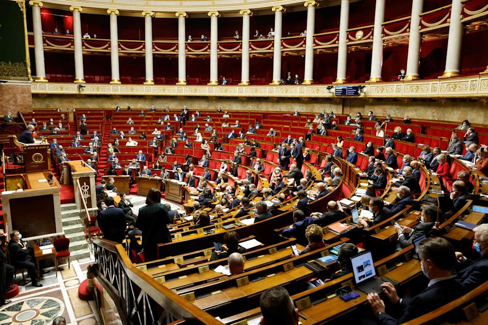 Politicians are shown in the French National Assembly in Paris on 9 February, 2021.  (AFP via Getty Images)