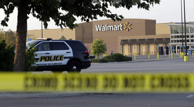 <p>San Antonio police officers investigate the scene where eight people were found dead in a tractor-trailer loaded with at least 30 others outside a Walmart store in stifling summer heat in what police are calling a horrific human trafficking case, Sunday, July 23, 2017, in San Antonio. (AP Photo/Eric Gay) </p>