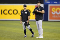 New York Yankees right fielder Joey Gallo, right, talks with Brett Gardner, left, before the team's baseball game against the Miami Marlins, Friday, July 30, 2021, in Miami. Gallo was acquired from the Texas Rangers in a trade. (AP Photo/Lynne Sladky)