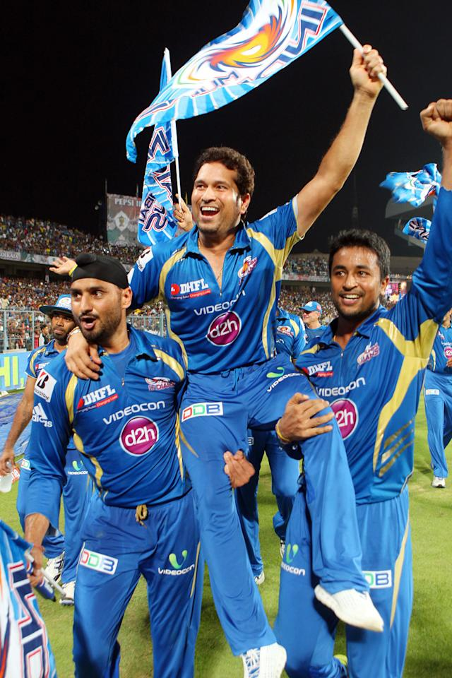 Harbhajan Singh, Sachin Tendulkar and Pragyan Ohja celebrate the win during the Final of the Pepsi Indian Premier League between The Chennai Superkings and the Mumbai Indians  held at the Eden Gardens Stadium in Kolkata on the 26th May 2013.(BCCI)