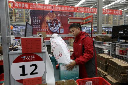 FILE PHOTO: An employee works at a JD.com logistic centre in Langfang