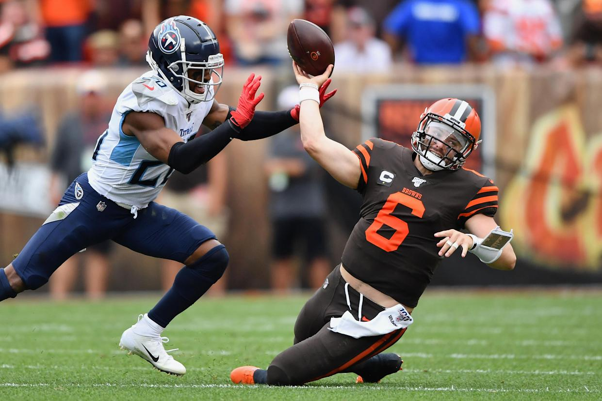 CLEVELAND, OH - SEPTEMBER 08:  Quarterback Baker Mayfield #6 of the Cleveland Browns is sacked by Logan Ryan #26 of the Tennessee Titans in the second quarter at FirstEnergy Stadium on September 08, 2019 in Cleveland, Ohio . (Photo by Jamie Sabau/Getty Images)