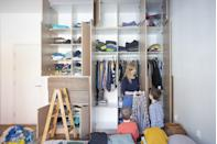 """<p>Vertical storage systems are perfect for homeowners who have a lot of stuff but not enough space. """"Start by locating studs with a stud finder, before deciding on shelf placement (mark with pencil),"""" says Marty Basher, home improvement expert with <a href=""""https://www.modularclosets.com/"""" rel=""""nofollow noopener"""" target=""""_blank"""" data-ylk=""""slk:Modular Closets."""" class=""""link rapid-noclick-resp"""">Modular Closets.</a> """"Attach brackets/cleats and slide the shelf plank on. As long as you have access to a drill and a stud finder, the process should take an hour or two at most."""" You can purchase kits or make shelves yourself and follow DIY tutorials.<br></p><p>You can also add organization to your existing closet. Let's say you've got a small closet that is laid out well, but you need additional storage space within it. For shelves, Basher recommends adding a few inexpensive shelf dividers to create more organized piles. Double the hanging space with an extender rod. A closet door is typically unused real estate, add hooks or hanging bars to the closet door. Under-shelf hanging baskets are perfect for smaller items like scarves, gloves, jewelry, or hand towels and wash cloths.</p>"""