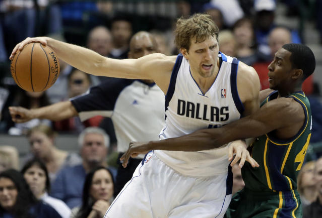 Dallas Mavericks forward Dirk Nowitzki (41) fights for position near the basket as Utah Jazz's Jeremy Evans, right, defends in the second half of an NBA basketball game, Friday, Feb. 7, 2014, in Dallas. Nowitkzi had 20-points in the 103-81 Mavericks victory. (AP Photo/Tony Gutierrez)