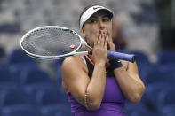 Canada's Bianca Andreescu reacts after defeating compatriot Romania's Mihaela Buzarnescu during their first round match at the Australian Open tennis championship in Melbourne, Australia, Monday, Feb. 8, 2021. (AP Photo/Hamish Blair)