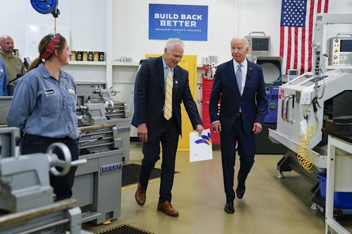 President of McHenry County College Clint Gabbard speaks as President Joe Biden tours a manufacturing lab at McHenry County College during an event highlighting infrastructure spending, Wednesday, July 7, 2021, in Crystal Lake, Ill. (AP Photo/Evan Vucci)
